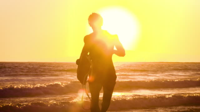 Male lifeguard running along the beach Male lifeguard running along the beach handsome people stock videos & royalty-free footage