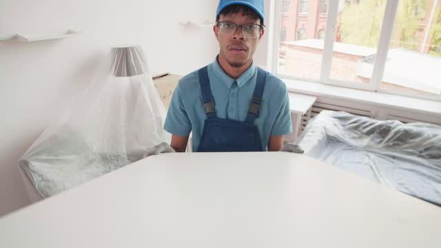 Male Loader Delivering Furniture