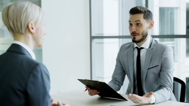 HR male manager shaking hand to female candidate after having job interview in modern office HR male manager shaking hand to female candidate after having job interview in modern office indoors job interview stock videos & royalty-free footage