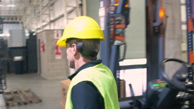 Male manual worker walking in metal industry video