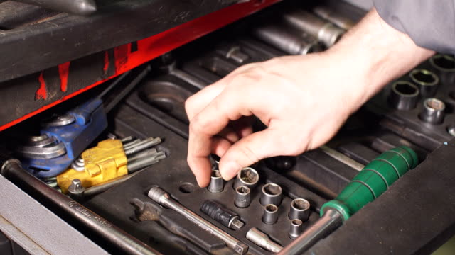 Male Mechanic Taking Instruments From Toolbox in Repair Garage video