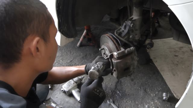 Male mechanic working in auto repair shop, Slow Motion