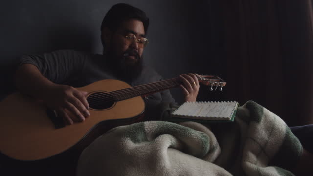 Male musician playing guitar