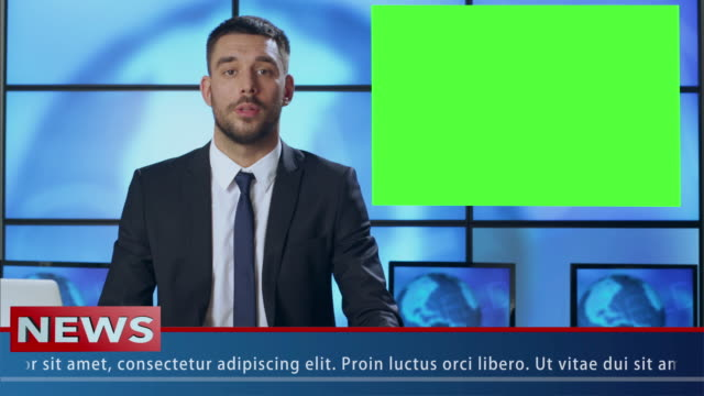 male news presenter in broadcasting studio with green screen display for mockup usage. - news video stock e b–roll