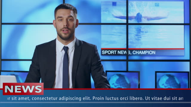 male news presenter speaking about sport news - servizi video stock e b–roll