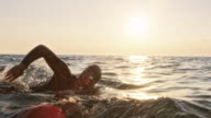 istock SLO MO TS Male open water swimmer swimming at choppy sea in sunshine 1024514616