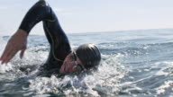 istock SLO MO Male open water swimmer swimming the front crawl in the sea on a sunny day 1024109886