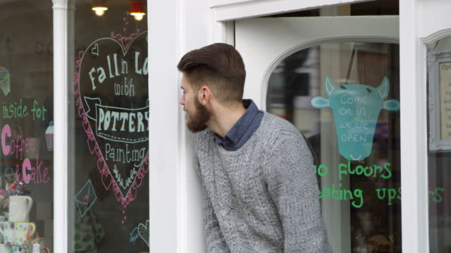 Male Owner Of Coffee Shop Turning Open Sign Shot On R3D video