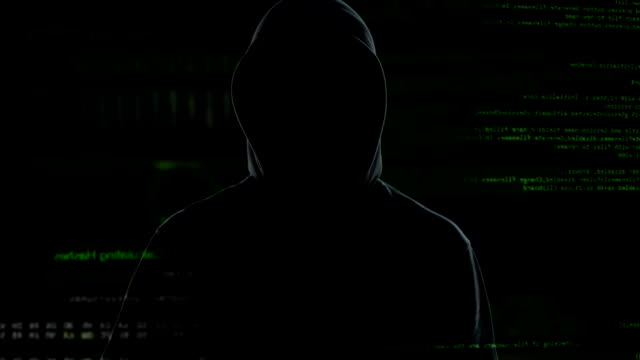 Male person in hood making stop sign, stop piracy and hacker attacks on Internet video
