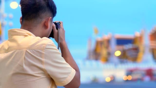 Male Photographer capturing photos at Wat Phra Kaew