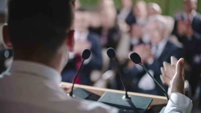 male politician delivering speech - democrazia video stock e b–roll