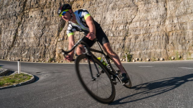 male road cyclist speeding downhill - evento ciclistico video stock e b–roll