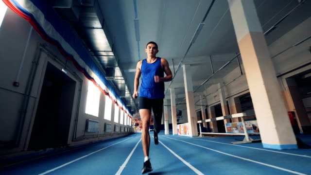 Male runner training with a prosthesis, bionic leg. Male runner training with a prosthesis, bionic leg. 4K amputee stock videos & royalty-free footage