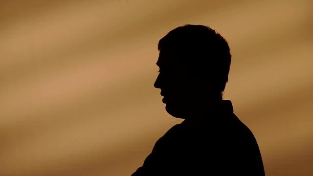 Male silhouette talking video
