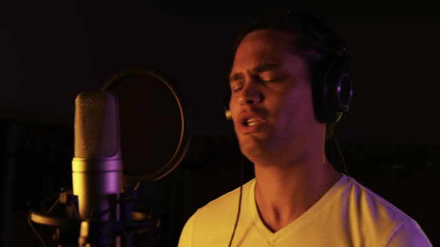 Male singer singing in a music studio