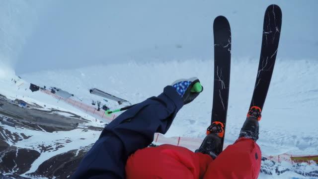 pov male skier riding in the half-pipe - sci freestyle video stock e b–roll
