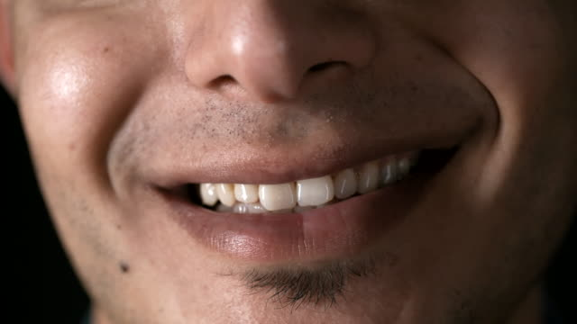 Male Smile Macro of male lower face, mouth and toothy smile implant stock videos & royalty-free footage