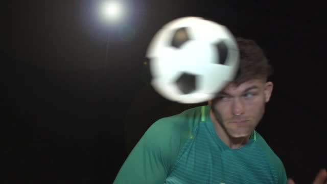 Male Soccer / Football Player heading the ball - Super Slow Motion 180 degree rotation