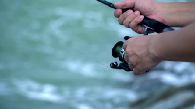 male spinning fishing rod summer outdoor activity - spranga video stock e b–roll
