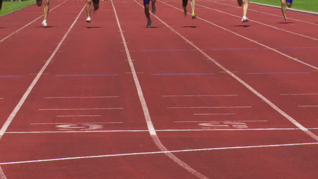 slo mo male sprinters at the finish line - track and field stock videos and b-roll footage