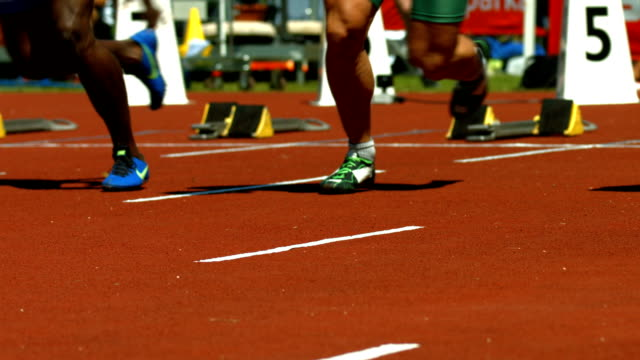 Male Sprinters Pushing Off Of The Starting Block video