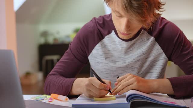 Male student listening to a teacher over an online platform