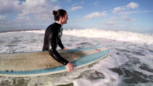 Male Surfer takes to the Sea video