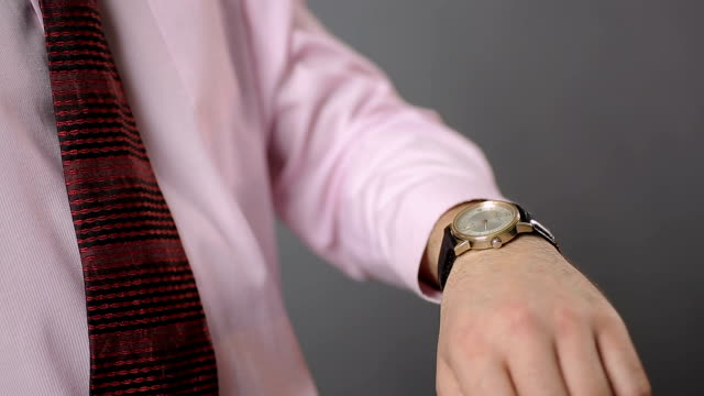 Male tapping his wrist-watch and checking time, broken mechanical watch video