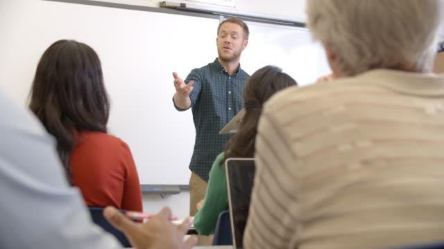Male teacher taking an adult education class, shot on R3D video