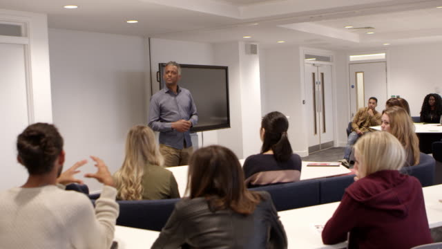 Male teacher talking with students in a university classroom, shot on R3D Male teacher talking with students in a university classroom, shot on R3D adult stock videos & royalty-free footage