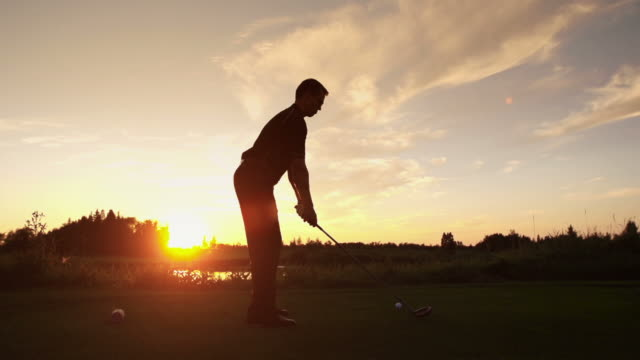 Male tees off at sunrise video