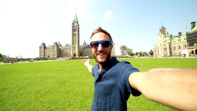 Male tourist taking selfie at parliament Hill Ottawa video