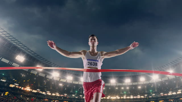 male track and field runner crosses finishing line - race stock videos & royalty-free footage
