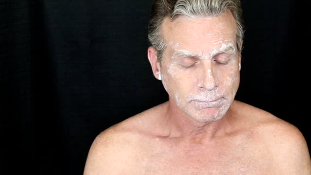 Male Turning to Each Side as a Bentonite Face Mask Dries video