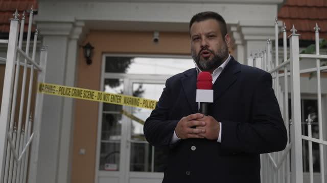 Male TV reporter at the crime scene video