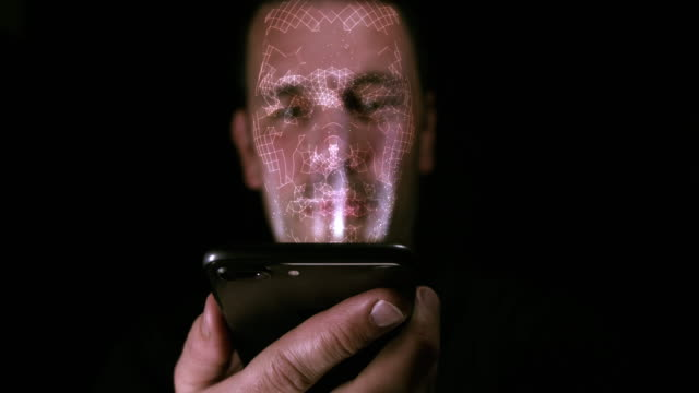 Male using his smart phone with facial recognition cameras Male holding his smart phone as it reads information of his face and uses facial recognition to unlock the phone. medical scanner stock videos & royalty-free footage