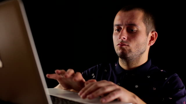 male using laptop notebook isolated black background video