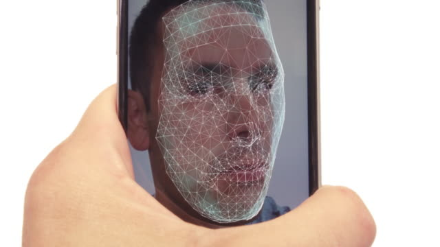 male using latest smartphone with facial recognition - facial stock videos & royalty-free footage