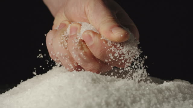 SLOW MOTION: Male's palm taking a handful of salt and smashes it indoors SLOW MOTION: Male's palm taking a handful of salt and smashes it indoors handful stock videos & royalty-free footage