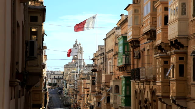 malta flag street and old house in malta malta stock videos & royalty-free footage