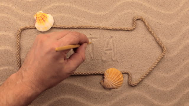 Malta inscription written by hand on the sand, in the pointer made from rope. video