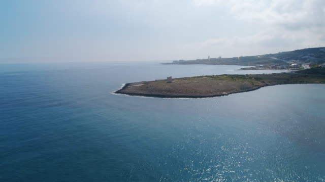 Maltese Coastline & Tower Drone footage over the Mediterranean sea in Malta towards an old fort. Shot in 4K malta stock videos & royalty-free footage