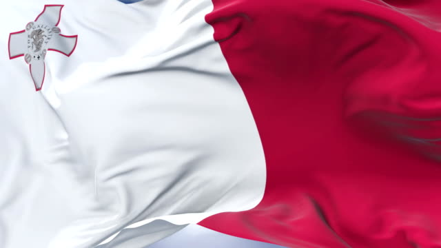 Maltese flag waving at wind with blue sky in slow, loop video