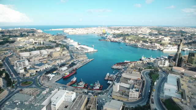 Maltese Town & Harbour Drone footage of a busy Maltese town (Marsa) and Grand Harbour with vehicles and ships, shot on a sunny day in in Autumn. malta stock videos & royalty-free footage