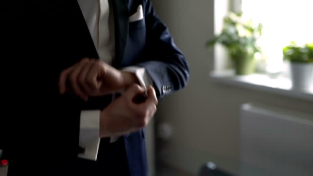 man adjusting sleeves. - wedding fashion stock videos and b-roll footage