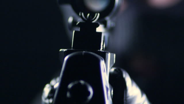 stockvideo's en b-roll-footage met man aiming with rifle - gun shooting