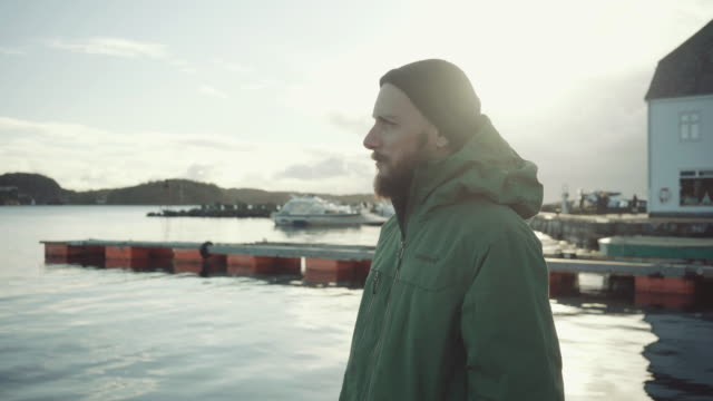 Man alone on a dock by the sea video