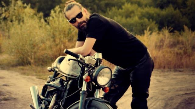 Man and his machine. Custom motorcycle