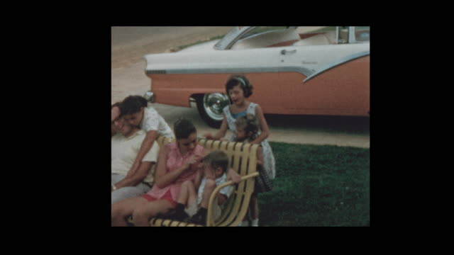 1958 Man and kids on rocking chair next to antique car 1958 Man and kids on rocking chair next to antique car rocking chair stock videos & royalty-free footage