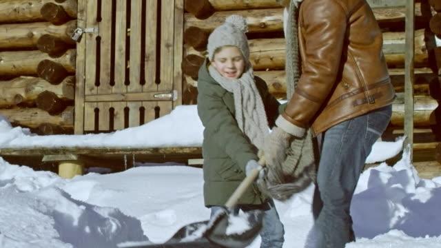 Man and Little Boy Shoveling Snow video